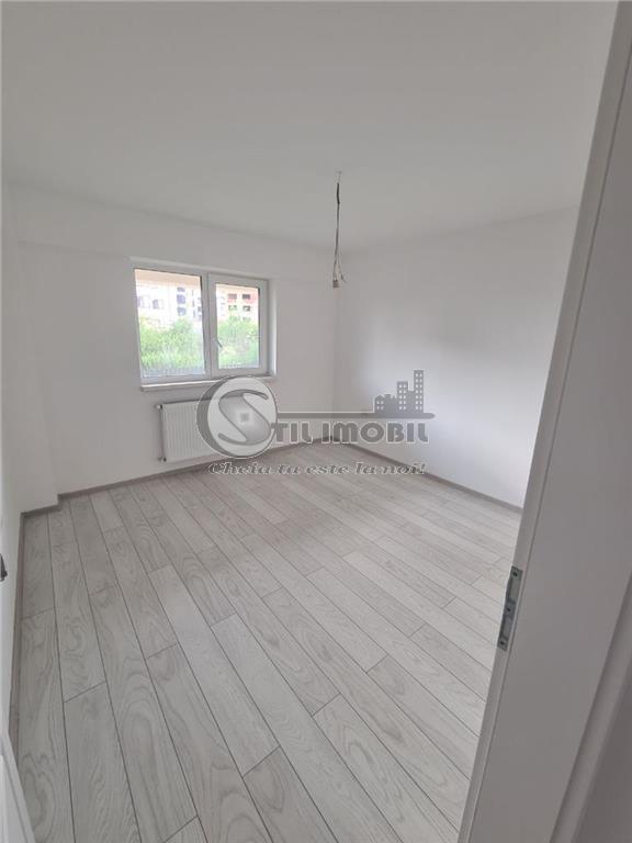 Apartament 3 camerede 56mp + teren de 50mp.